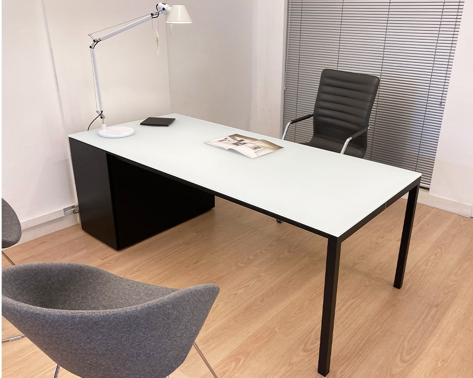 Minimimu glass executive desk - satin white glass top with a matt black lacquered structure and lockable drawers