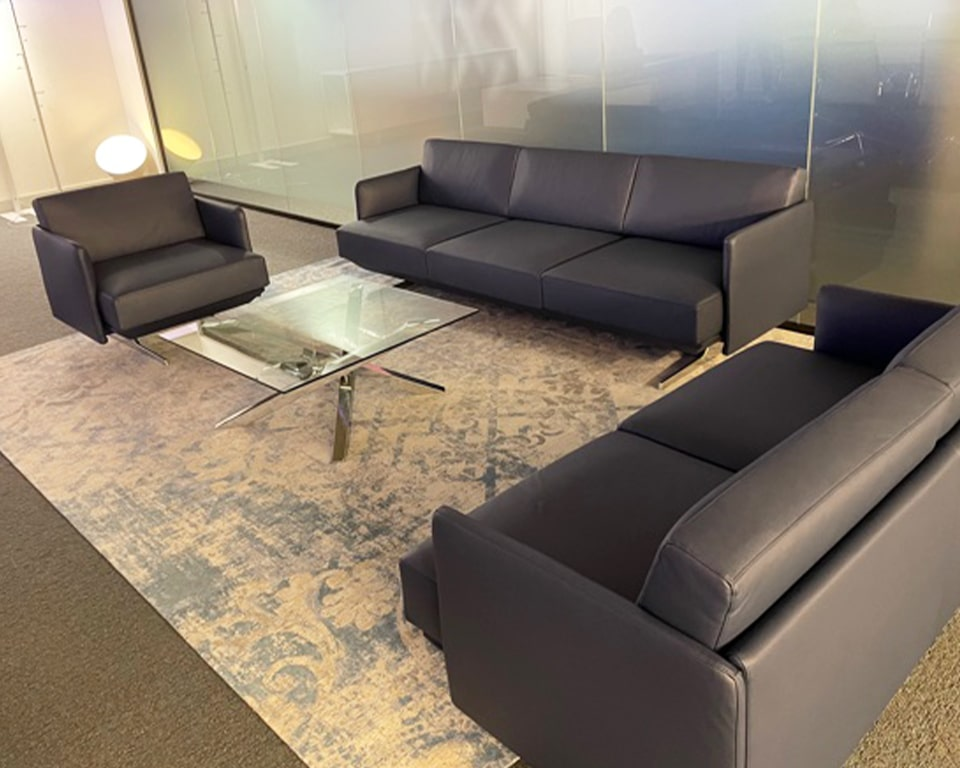 Hugo High quality Italian sofas and armchairs in real Italian blue leather with die cast aluminium blade feet.
