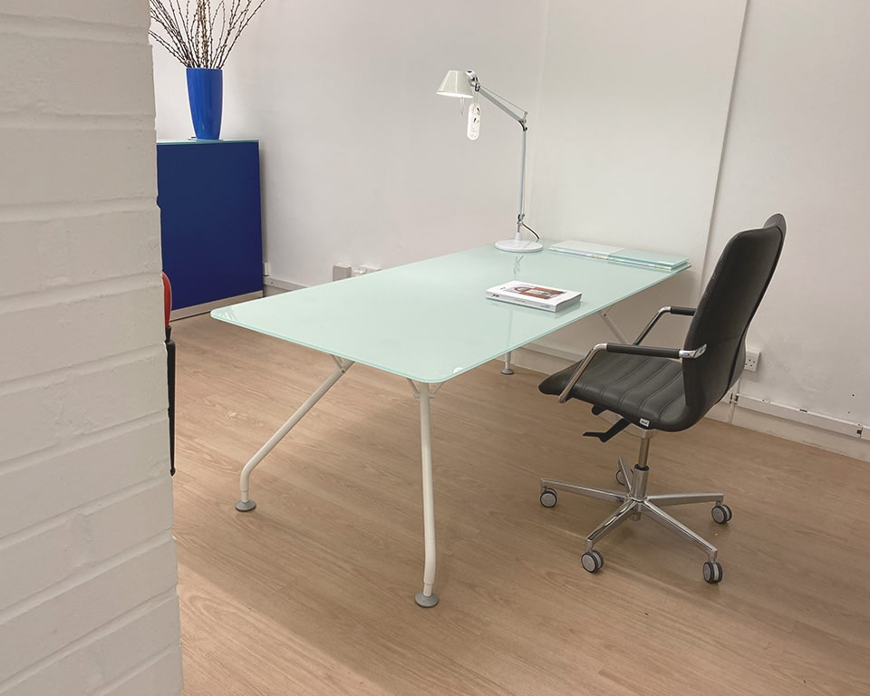 Large glass table or desk with a frosted glass top and stylish white legs