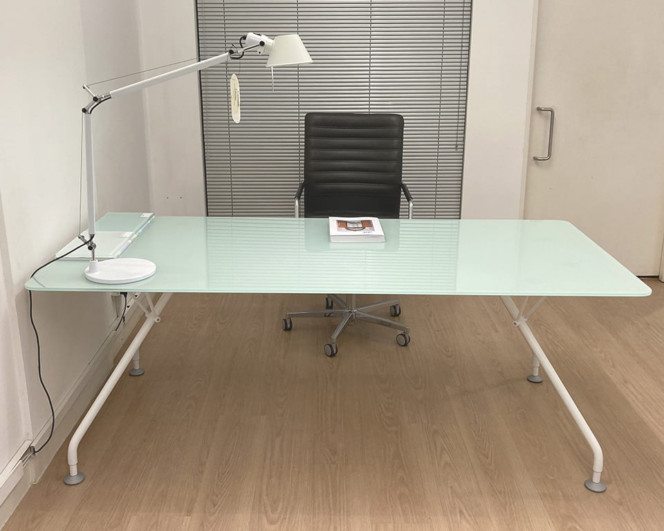 Large glass table or desk with a frosted glass top and white legs